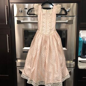 Beautiful girls dress trimmed with crochet lace